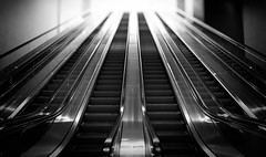 Going Up (Darren LoPrinzi) Tags: 5d canon5d ny nyc newyork urban canon city miii escalator steps stairs bw blackwhite blackandwhite mono monochrome focus blur bokeh depthoffield manhattan lowermanhattan worldtradecenter freedomtower up goingup metallic
