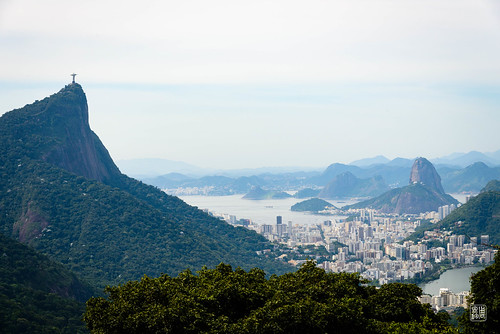 Christ the Redeemer atop Corcovado Mountain overlooking Urca & Sugarloaf Mountain