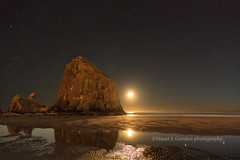 Moonset at Haystack Rock (chasingthelight10) Tags: events photography landscapes ocean nature rockformations seascapes places oregon oregoncoast cannonbeach haystackrock otherkeywords nightphotography moonrise moonset