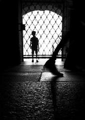 trapped outside (/ urban.fishing /) Tags: dresden schlos castle boy dark dungeon trapped locked hide silhouette shoe motion blur walk look urban contrast