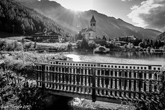 Bridge at the end of the day (Gian Floridia) Tags: ortler ortles solda sulden bn bw backlight bienne bridge campanile controluce laghetto ponticello