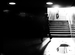 hurry up! (René Mollet) Tags: hurry underground man blackandwhite bw dark light backlight street streetphotography shadow streetart silhouette renémollet move