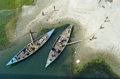 Unloading sand! (ashik mahmud 1847) Tags: bangladesh d5100 nikkor sand river boat water people working group light shadow aerial