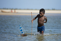 Young Veso Boy (Daniel Trim) Tags: travel veso fisherman boy playing with boat toy home made belo sur mer nomadic people madagascar africa