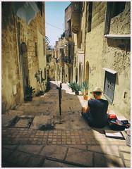 The Malta Experience (2) (kurtwolf303) Tags: vittoriosa malta europe europa person street strase stufen gebäude buildings steps gasse olympusem1 omd microfourthirds micro43 systemcamera mirrorlesscamera spiegellos mft kurtwolf303 unlimitedphotos insel island strasenfotografie streetphotography urbanlifeinmetropolis reisefotografie travelphotography texture textur topf25 250v10f topf50 500v20f