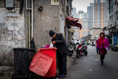 one mans rubbish (Rob-Shanghai) Tags: shanghai china street rubbish collector leicaq leica people hardlife bin trash city lane alley