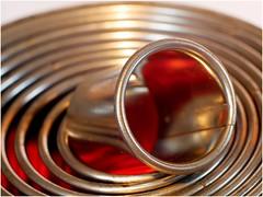 Pastry Cutters (jesse1dog) Tags: memberschoicefoundinthekitchen macromonday rings pastryrings circles metal red extensiontube gm1 meyeroptikgörlitz trioplan50mm