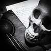 Skull and Haunted Book (Austin Hudson) Tags: skull book medallion cursed haunted creepy black white monochrome