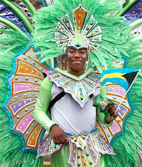 Green Feathers (englishreader) Tags: nottinghamcaribbeancarnival nottinghamcaribbeanfestival nottingham caribbeancarnival caribbeanfestival carnival festival performers performer entertainment entertainer person people portraiture peoplephotography portrait portraitphotography man male boy youngman greenfeathers green blue purple pink orange yellow jewels colour color colors colours colorful colourful brightcolours brightcolors headdress costume daylight availablelight naturallight