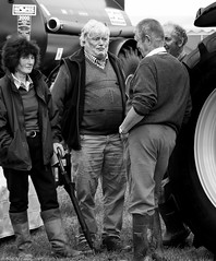 Wheels and deals (Neil. Moralee) Tags: middevonshow2017neilmoralee neilmoralee farmer tractor man men woman wife farmers deal wheel wheeling dealing tank muck spreader silage boots wellingtons mud face old mature people black white mono monochrome bw bandw blackandwhite devon show neil moralee nikon d7200 candid undercover trade barter girlfriend mistress companion beard uk tiverton money