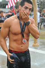 Face Wipe (Chris Hunkeler) Tags: shirtless male man athlete wet marinecorpsmudrun bare chest barechested face wipe
