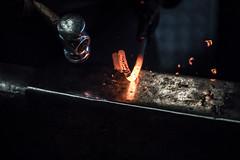 Blacksmith at Work (Pittypomm) Tags: blacksmith anvil hammer meatl bend bending bent sparks redhot red hot chrome
