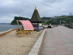 Some of the seafront (southglosguytwo) Tags: 2017 august cloudy devon sea teignmouth giantdeckchair buildings