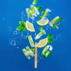 Ice cube lettering with frozen mint leaves, lemon slices and oranges on a blue background with water splashes. Text says Aloha (Dina Belenko) Tags: alphabet background blue citrus cocktail cold color concept cool cube design drink food freeze fresh freshness frozen fruit glass healthy ice icecream ingredient lemon lemonade letter lettering macro melt mint natural organic party popsicle refreshment season slice stilllife style summer sweet text topview tropical type typography water word khabarovsk khabarovskterritory russia