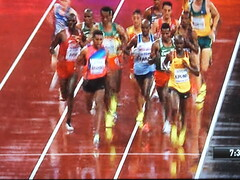 Abstract reflections.... Mo Farah doing what he does... (Sue - see you in the autumn...) Tags: london2017 mofarah athletics stadium tv red running