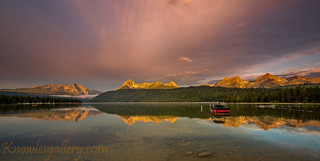 Boat on Redfish lake as the morning light hits the high mountain tops