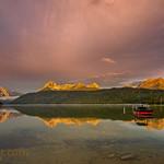 Boat on Redfish lake as the morning light hits the high mountain tops thumbnail