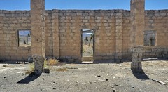 Picture Window (tcees) Tags: fv4 barranco grantarajal fuerteventura posts ruin windows door palmtree weeds bricks x100 fujifilm sky urban walls