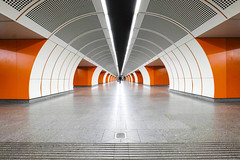 Orange Tube (CoolMcFlash) Tags: tube tunnel vienna westbahnhof station architecture fujifilm xt2 symmetry symmetrie durchgang wien architektur fotografie photography urban city stadt xf 1024mm f4 r ois person streetphotography subway ubahn