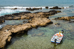 Boat at walls of Alghero (Mariusz Hojda (k0g00t)) Tags: boat imagevall rock water alghero sardiniaisland italy