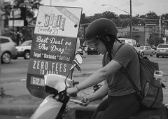 Zero Fees (Halcon122) Tags: pretty girl scooter helmet street streetphotography candid bw austin texas olympusem5markii