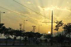 Como no pude fotografiar la luna (Micheo) Tags: granada spain sunset summertime metro sunrays vegadegranada sierraelvira poles postes