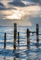 Storm sky over Strangford Lough (Donard850) Tags: countydown northernireland strangfordlough longexposure oldpier pier rainbow sea stormclouds stumps water