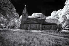 Medieval house of worship (David Feuerhelm) Tags: outdoors bw blackandwhite monochrome noiretblanc schwarzundweiss contrast infrared ir convertedcamera church building old historic history wideangle roof tower trees countryside rural essex england nikon d90 sigma1020mm