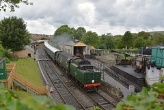 Southern Railways Battle of Britain Class Pacific Loco No.34070 'Manston' arrives at Swanage, with a service from Norden. Swanage Railway. 22 07 2017 (pnb511) Tags: train rails railway loco locomotive green trees steam engine shed turntable coaling stage track