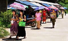 Burmese people near Mae Sot, Thailand (JJ Doro - Bangkok) Tags: burmese maesot moieriver myanmar rimmoie seasia thaimyanmarfriendshipbridge thailand thanaka umbrella asia asian asianmarket umbrellas tambonthasailuat tak th