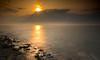 Sunset over zeeland (fire111) Tags: sunset zonsondergang zeeland netherlands nederland zon water zee sea sun rocks le nikon explore