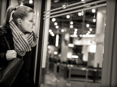 longing (grizzleur) Tags: airport candid candidphotography candidportrait candidstreetphotography street streetphotography streetportrait streetcandid omdstreetphotography bw mono monochrome bokeh bokehlights window longing goodbye seperation look girl woman young pretty beautiful