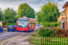 New Buses For Route 379 (M C Smith) Tags: bus red garden pavement road kerb flowers pentax k3ii trees green bushes pink cars traffic parking yellow lines wall sky blue clouds white houses grass bin signs