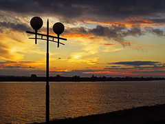 River. Sunset. Lamppost (AzIbiss) Tags: river water sunset reflection sun dusk shore landscape orange red sky yellow cloud treeline riverscape waterscape summer canon canondigital canonphotography canonsx50 powershot sx50 hyperzoom outdoor amateur july tomsk westernsiberia russia tomriver tom current flow course stream rivercourse gleam bright evening serene glisten glow reflex mirror serenity bank fluvial twilight extreme salient riverine tree lamp lamppost streetlight round duo sharp grass lightpillar lamppole light