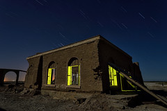 the ice plant. salton sea, ca. 2016. (eyetwist) Tags: eyetwistkevinballuff eyetwist abandoned ruins adobe dryice mineralspa mudpots saltonsea night desert dark nikon nikond7000 d7000 nikkor capturenx2 1024mmf3545g 1024mm fullmoon photography tripod npy nocturne longexposure derelict ruin california imperial sonorandesert salton sea startrails decay c02 ice factory forgotten mud geothermal building structure architecture leaning sky windows yellow lightpainting