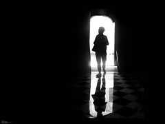 enter a holy place (René Mollet) Tags: holy people penf place reflection lowkey woman door indoor silhouette shadow street streetphotography streetart church magic candite renémollet 35mm lugano
