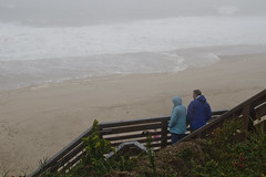 Storm Watchers (brucetopher) Tags: sea foam ocean waves wave water tide surge stormsurge breakers surf coast seacoast beach watch people man woman raincoat coat coats blue weather fog rain hurricane tropicalstorm gale wind windy watching stairs overlook