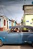 One Way (againandagain251) Tags: camagüey cuba bigcar classiccar streetlife telegraphlines colourfulbuildings cooldude goodtaxidriver