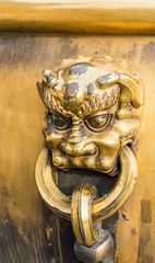 Cloesup of ornate bronze handle on water urn at the Entrance to the Gate of Heavenly Purity, or Celestial Purity (Qianqingmen), Beijing (Victor Wong (sfe-co2)) Tags: ancient animal antique art asia asian beijing brass bronze celestial china chinese city closeup culture decoration design detail doorknob doorknocker dragon forbidden gate golden gugong handle head heavenly heritage history imperial knob knocker lion macro metal metalwork mythology oldfashioned oriental ornate outdoors palace purity qianqingmen ring sculpture traditional urn