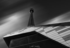 Looking up at the CN Tower (Alec_Hickman) Tags: toronto cn tower cntower blackandwhite noiretblanc monochrome architecture light shadow buildings perspective pov lowpov sky cloud canada ontario city landscape cityscape windows tall skyscraper