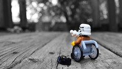 Hmmm... (RagingPhotography) Tags: lego star wars imperial galactic empire black white outside outdoor plastic toy toys minifigure minifig figure stormtrooper wheelchair disabled camera ice cream cone wood playground ragingphotography