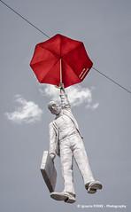 Man with red umbrella, Prague #12 (Ignacio Ferre) Tags: prag praha praga prague czech czechrepublic moravia bohemia checoslovaquia chequia repúblicacheca europa europe man hombre paraguas umbrella red rojo art arte modern moderno modernart artemoderno nikon