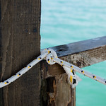 Tied rope on sea background thumbnail