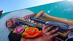 Mural by Irving Cano (Eric Flexyourhead) Tags: vancouver canada britishcolumbia bc mountpleasant eastvan city urban detail fragment mural art artwork irvingcano musician woman sax saxophone colourful vibrant vivid sky blue clear summer sunny bluesky blueskies lensflare 169 olympusem5 panasoniclumix714mmf40