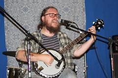 Invisible Public Library (D Johnston) Tags: lawrencekansas lovegarden banjo musician