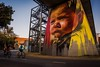 Inscrutable stare. 13/100 (jenniferdudley) Tags: australia merivalestreetbridge thepillarsproject westend queensland brisbane nikkor nikon2470mm nikondslr nikond4s nikondsr nikon culture aboriginal boy aborigine streetart mural graffiti art
