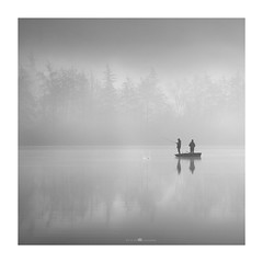 black pines in the mist (paolo paccagnella) Tags: phpph© inthemist bn bw phpph © allrightsreserved wwwphpphotographycom blackandwhite lakescape fog fisherman boat italy veneto territorio fineart ambiente canon eos5dm3 ef70200isusm best photo paolopaccagnella photographer mist monochrome 8