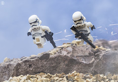 Running Troopers (jezbags) Tags: lego legos legostarwars toys toy starwars stormtrooper stormtroopers troopers trooper minifigure minifigures macro macrophotography macrodreams canon60d macrolego canon 60d 100mm closeup upclose running fire gun jump rocks sand beach