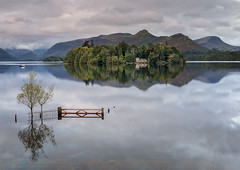 Crow Park, Derwentwater, Lake District (MelvinNicholsonPhotography) Tags: crowpark derwentwater lakedistrict cumbria lake water gate island boathouse boat trees fence sky clouds mountains melvinnicholsonphotography