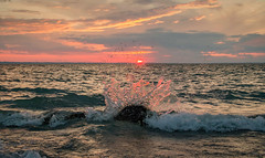 Sunset Splash (T P Mann Photography) Tags: lake michigan sun light red color wave splash nature sunset sundown serenity shore beach canon t3i eos digital tamron dslr rock seascape horizon summer evening dusk sky clouds breath taking landscapes ngc
